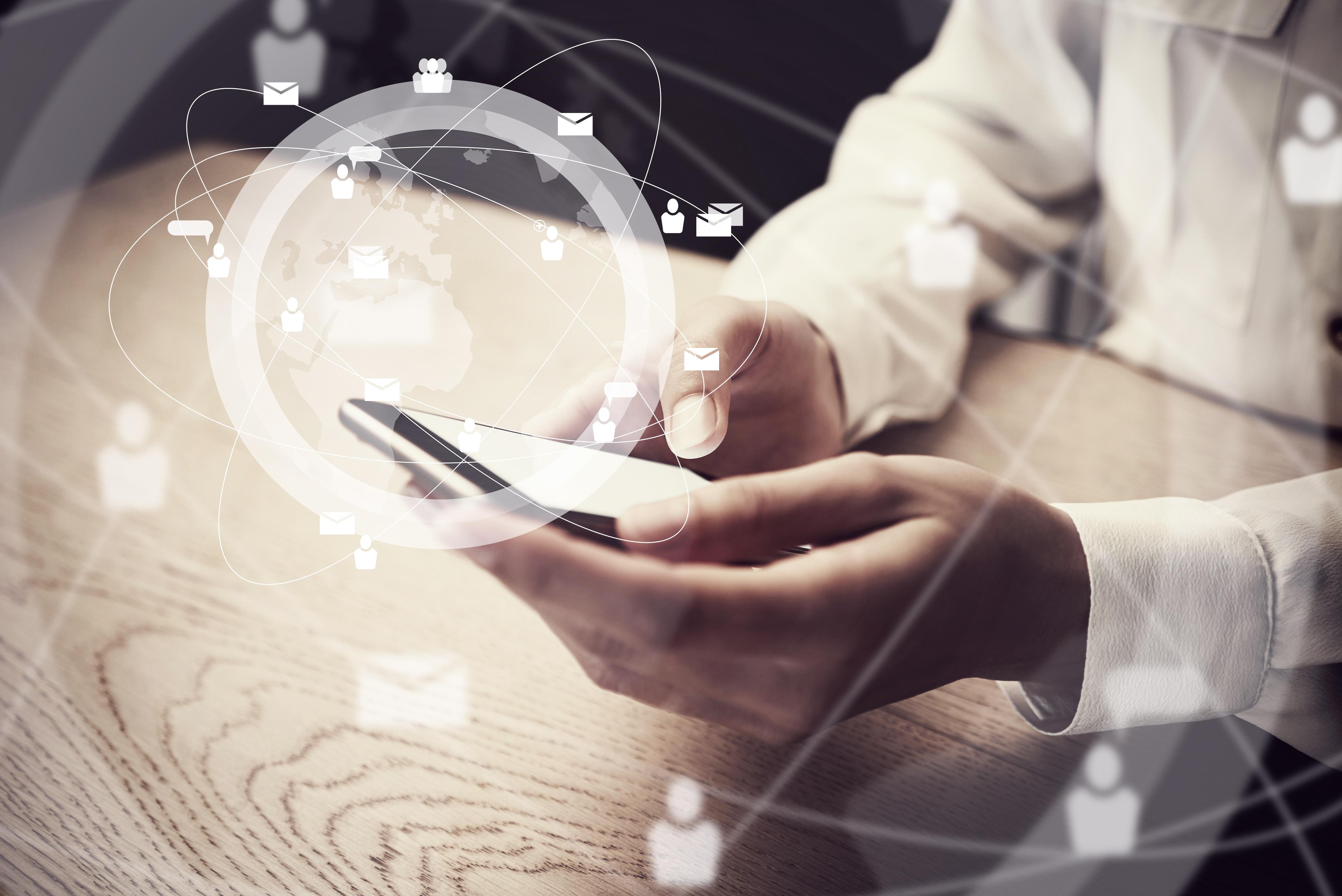 Generic-design-smartphone-holding-in-female-hands-texting--message.-Digital-511733570_4240x2832.jpeg